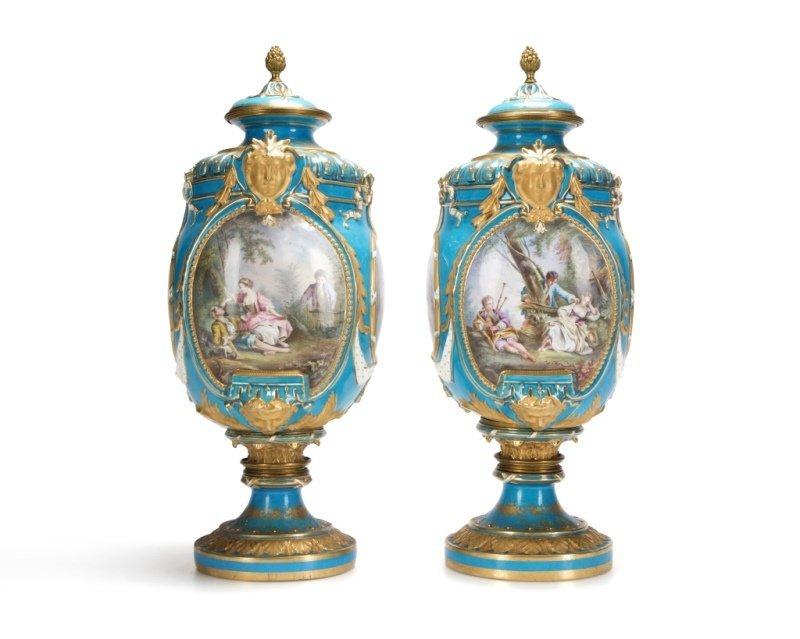 Pair of Sevres bleu celeste porcelain lidded urns