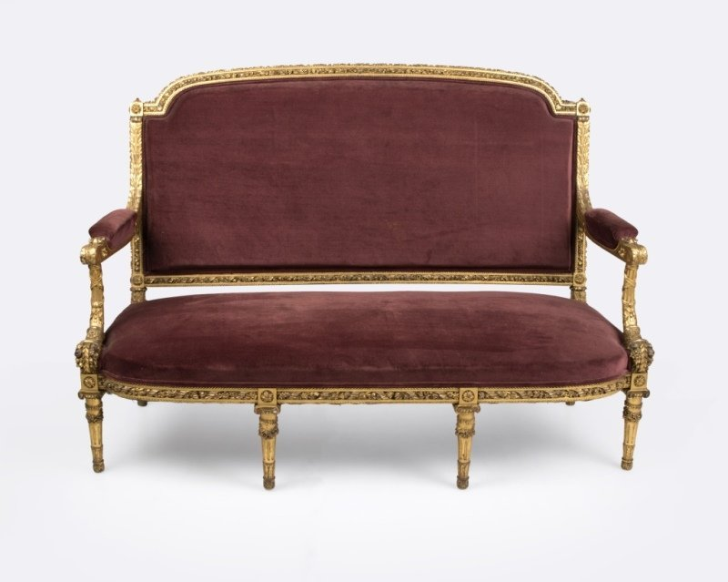 A Louis XVI-style carved giltwood settee