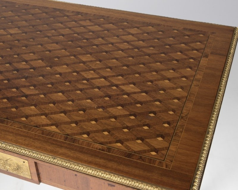 A Louis XVI-style parquetry library table - 2