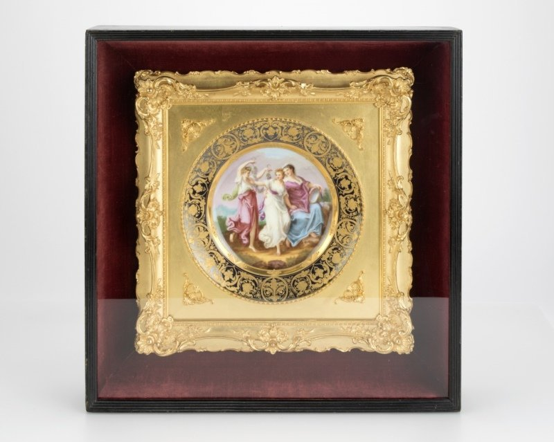 A framed Royal Vienna porcelain plate