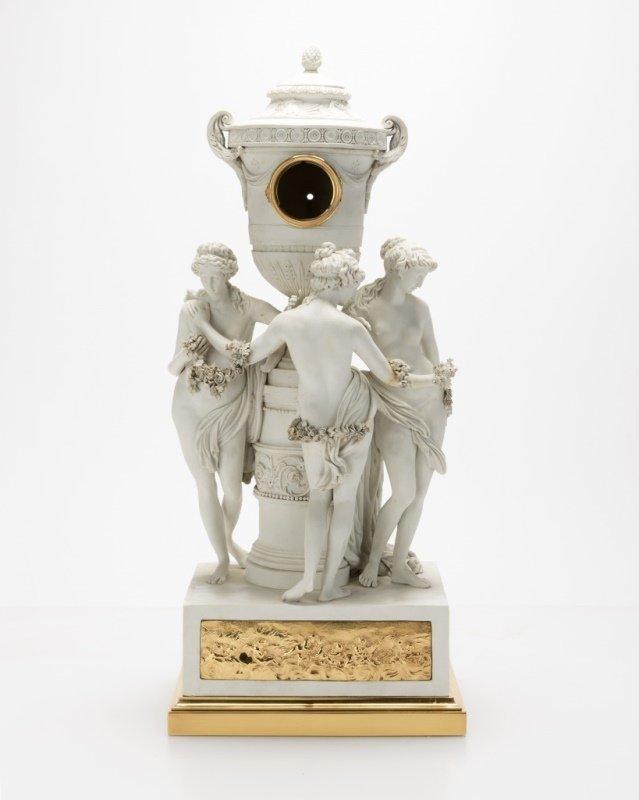 A Sevres gilt bronze-mounted bisque figural clock