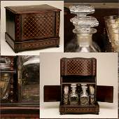 A FRENCH KINGWOOD PARQUETRY AND EBONIZED TANTALUS