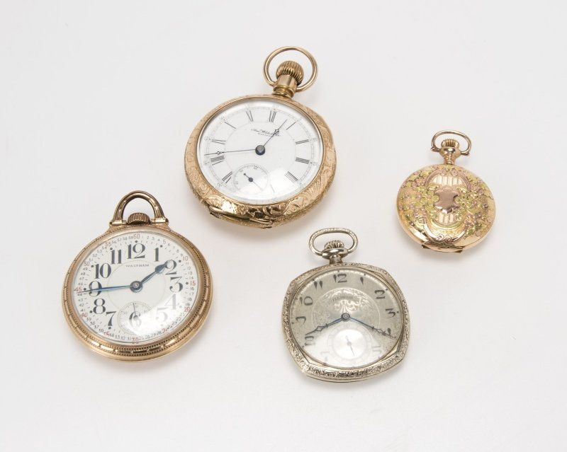 A group of four gold-filled pocket watches