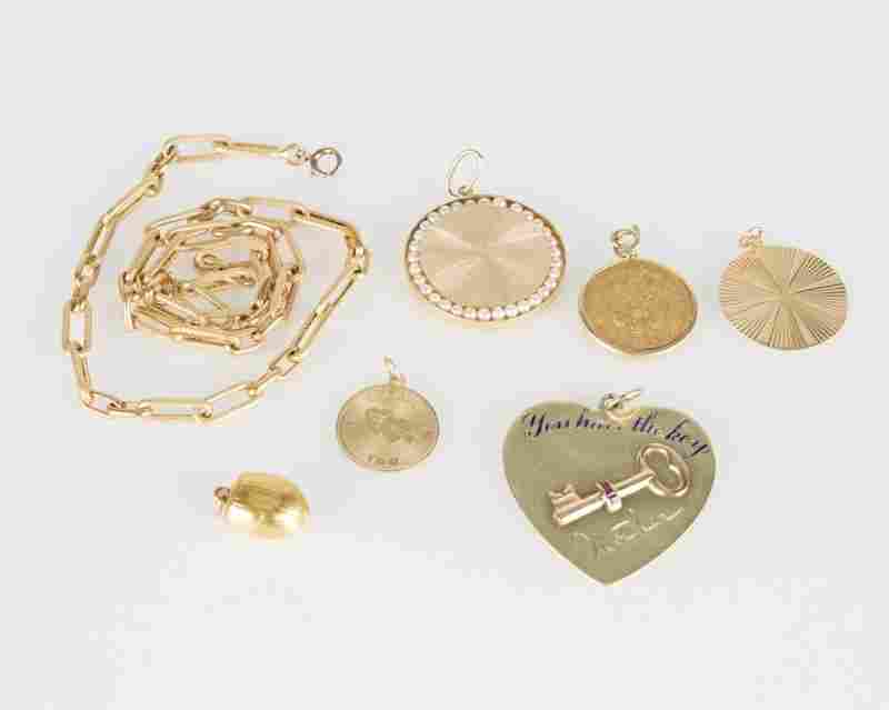A group of seven gold jewelry items