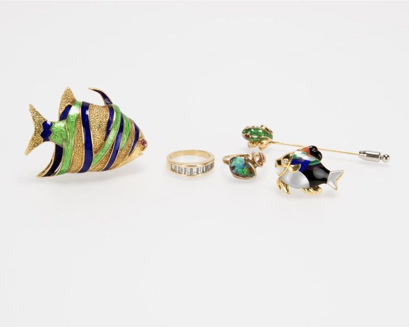 A group of rings and enamel animal-form brooches