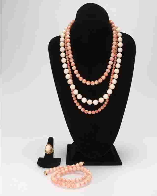 Five coral jewelry items