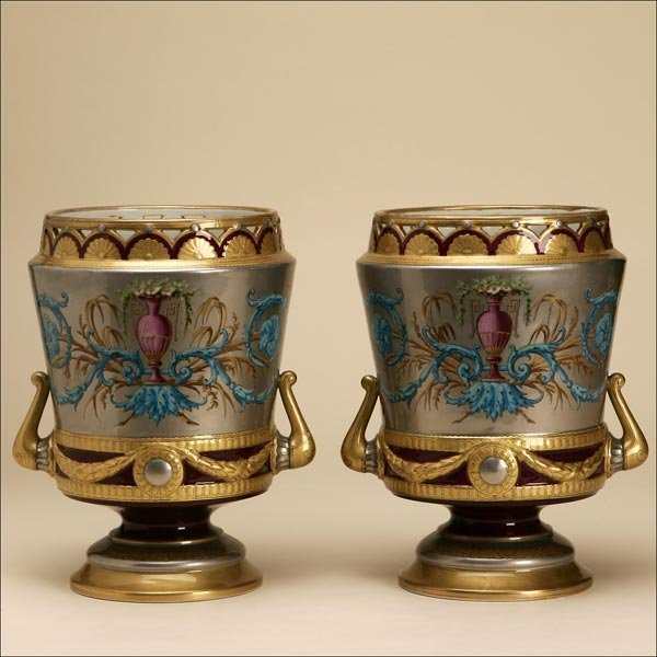 1006: A PAIR OF POLYCHROME-PAINTED PORCELAIN CACHEPOTS