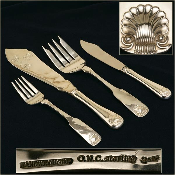 1010: AN ONC STERLING SILVER FISH SET
