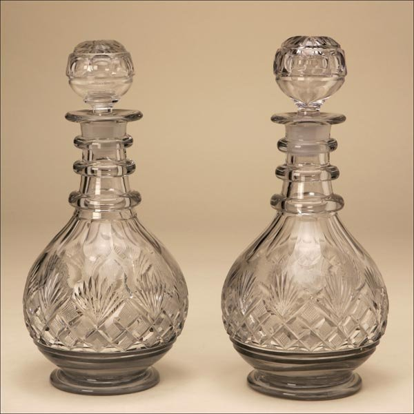 1022: A PAIR OF CUT-GLASS DECANTERS