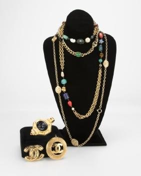 A group of costume jewelry including Chanel