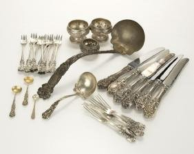 A group of assorted sterling silver flatware