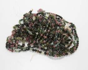 A group of tourmaline bead jewelry