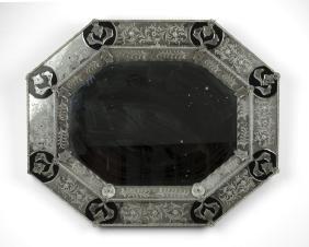 A Venetian glass wall mirror