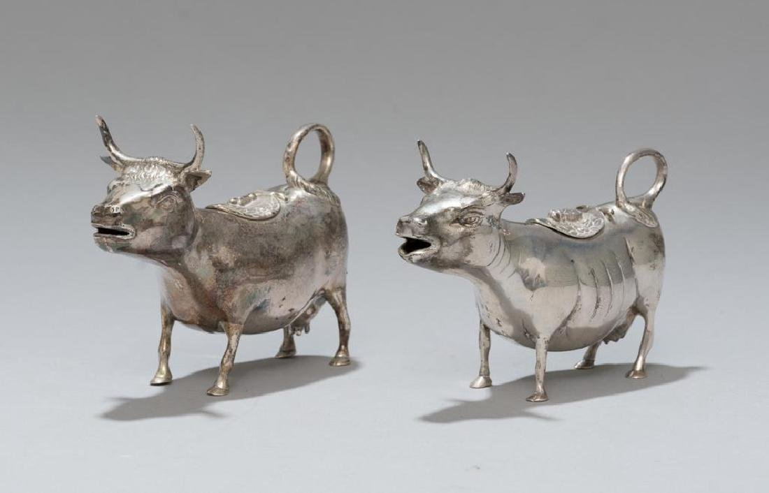 Pair of Sterling Silver Cow Form Creamers