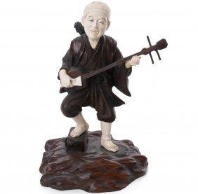 Japanese Bronze And Ivory Okimono Of Man Playing The