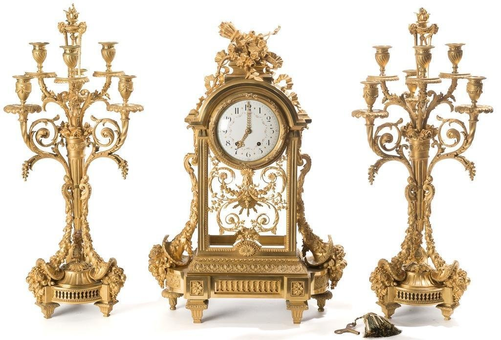 IMPORTANT 19TH C. MERCURY GILDED CLOCK AND GARNITURE