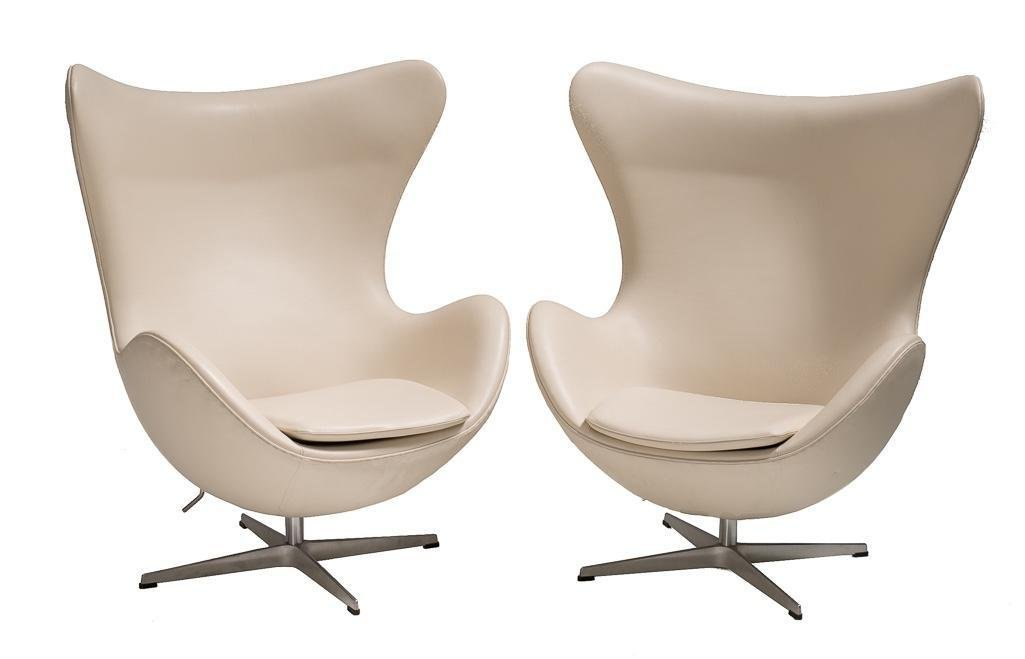 Two Arne Jacobsen Leather Egg Chairs