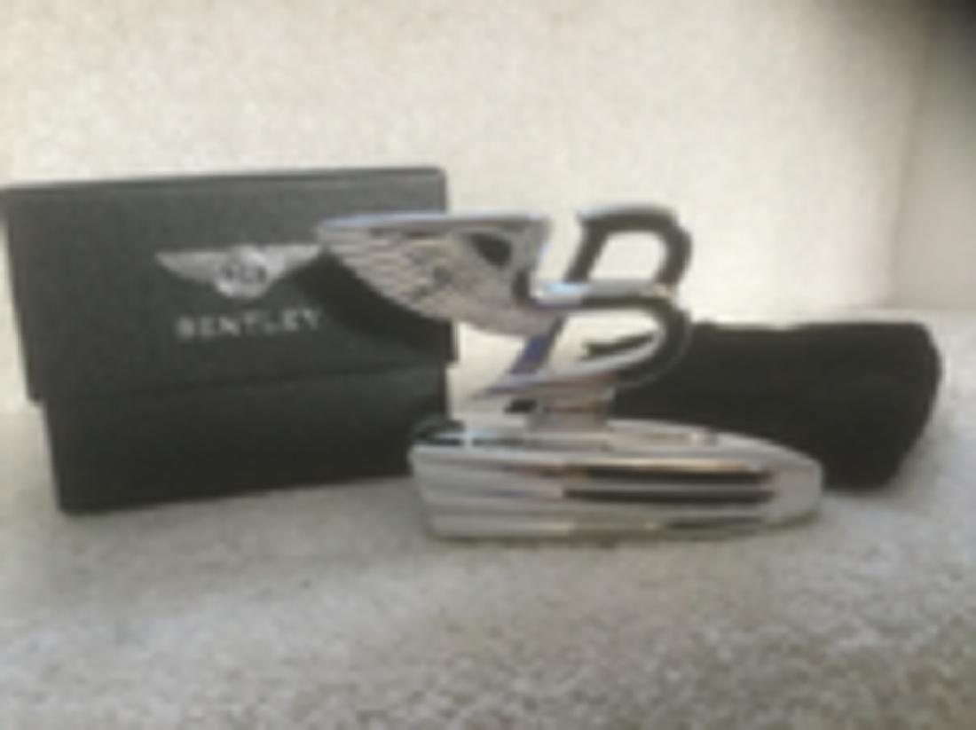 """Bentley Flying """"B"""" paperweight."""