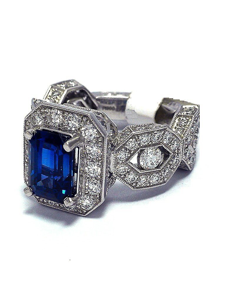 Platinum ring with non heated sapphire and diamonds