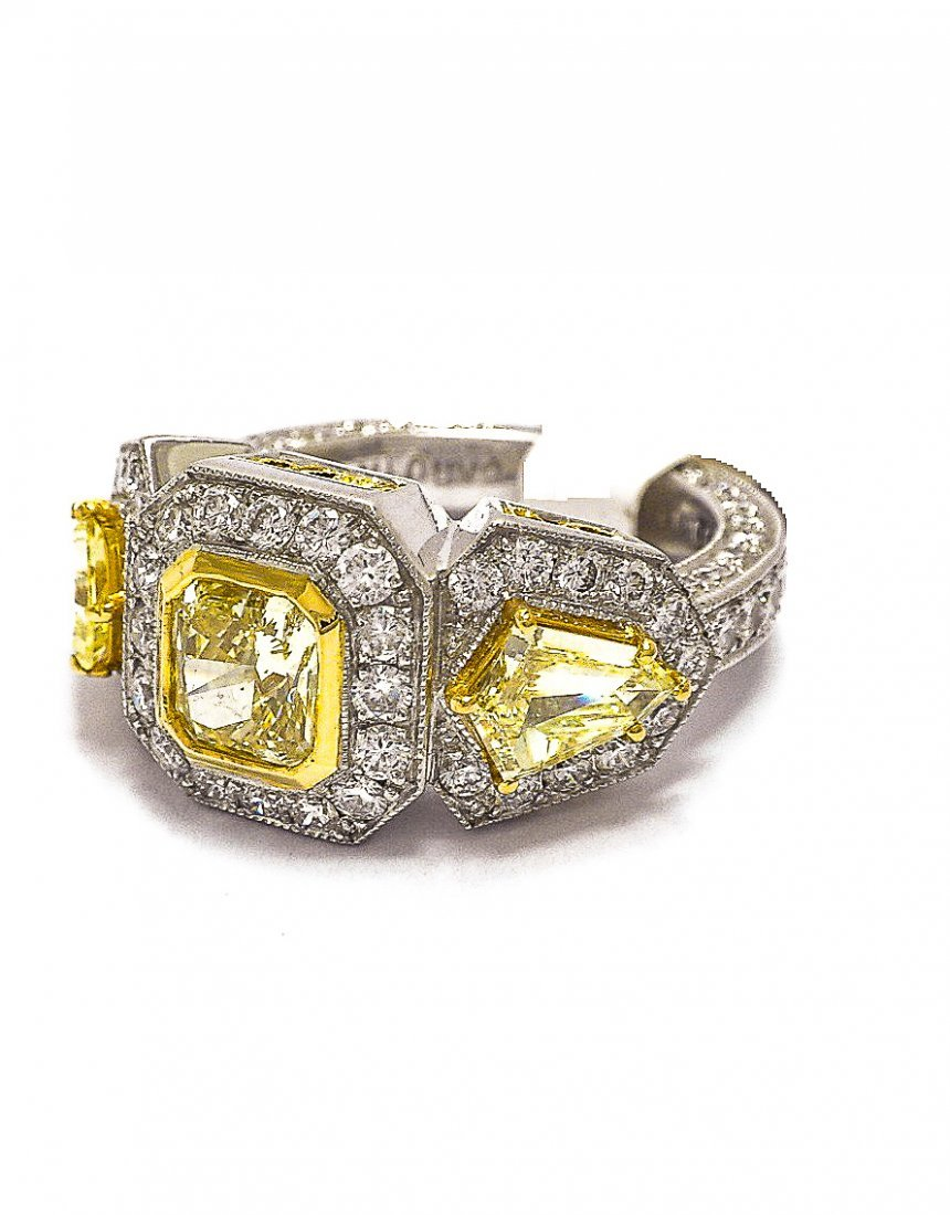 Platinum. Fancy Yellow Diamond Ring