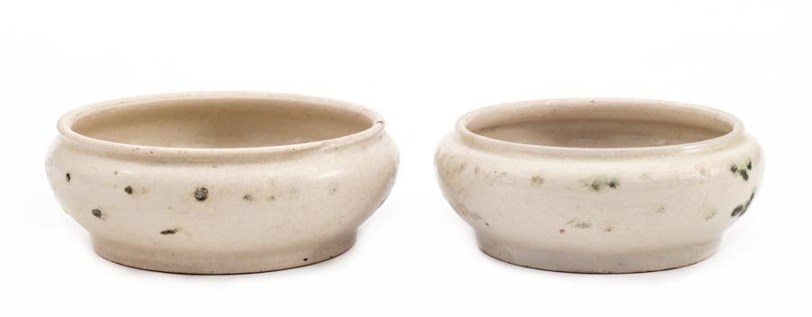 A pair of shallow bowls with blue decoration
