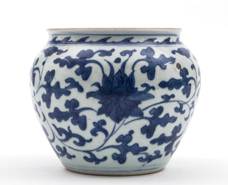 A blue and white jar with floral design
