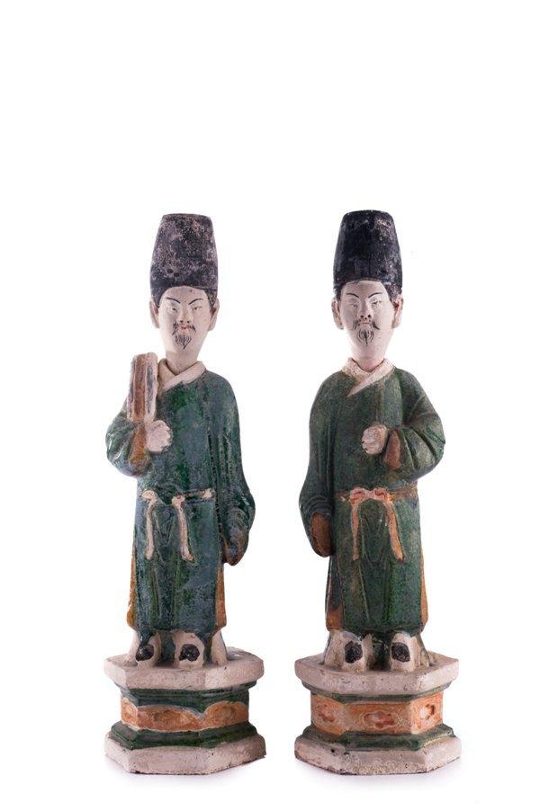 ming dynasty, pair of sancai-glazed pottery figure of