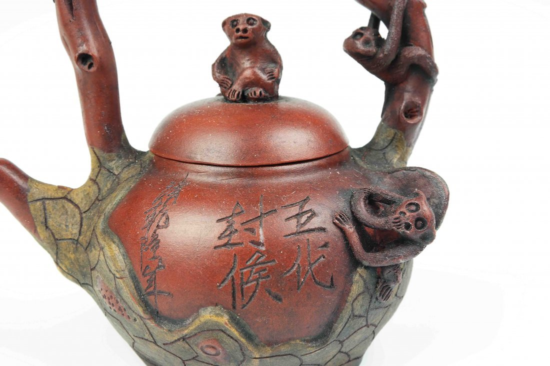 a zisha teapot with five monkeys - 2