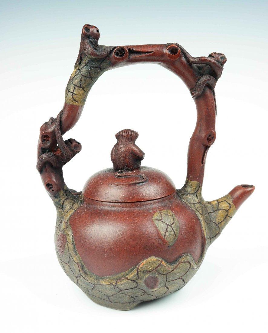 a zisha teapot with five monkeys - 3