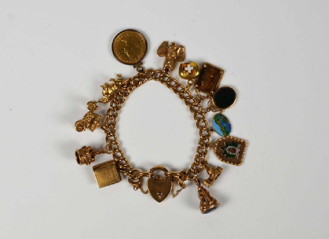 ENGLISH GOLD CHARM BRACELET W/ 13 ASSORTED CHARMS