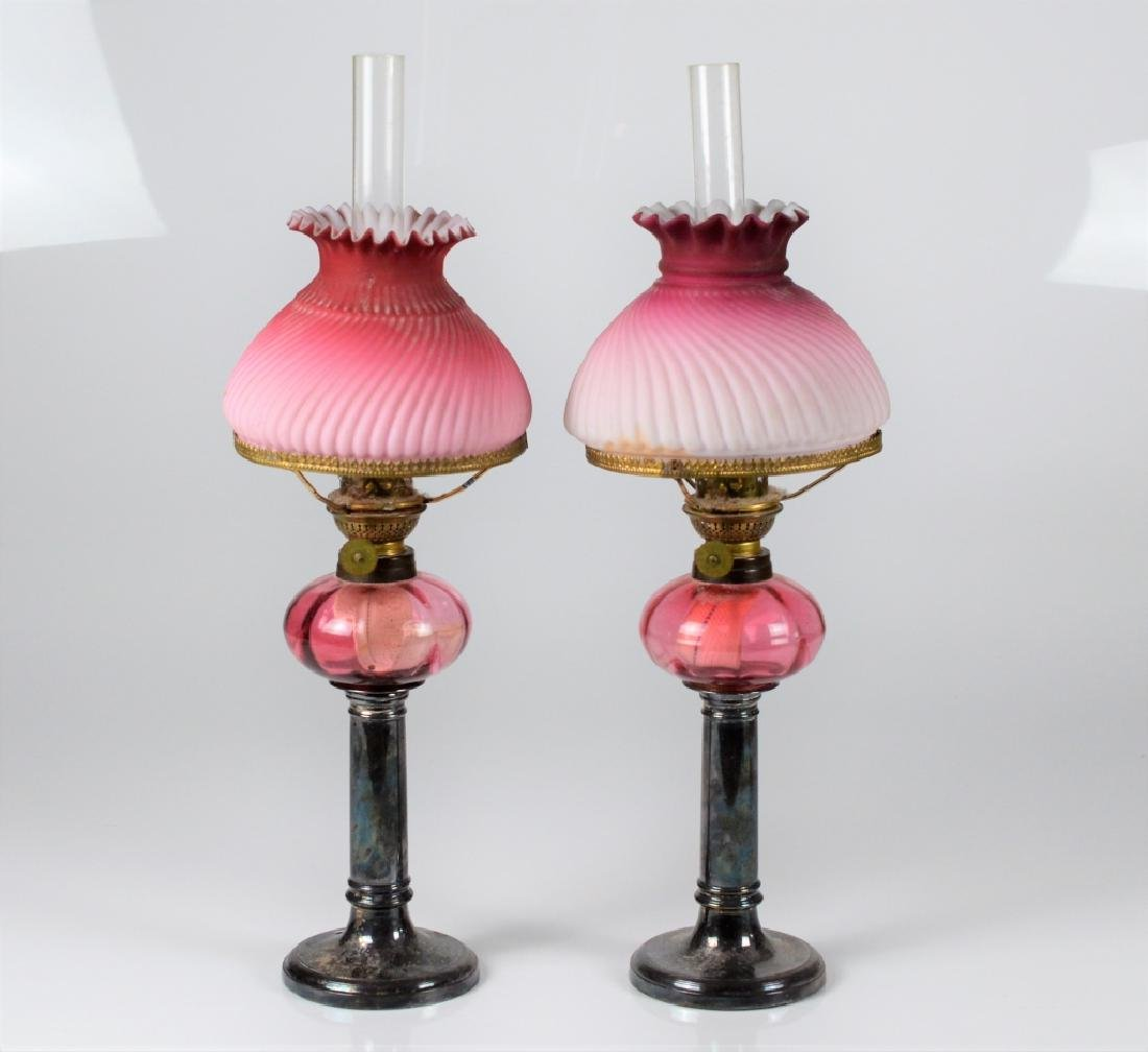 PAIR OF ANTIQUE GLASS & SILVERPLATE OIL LAMPS