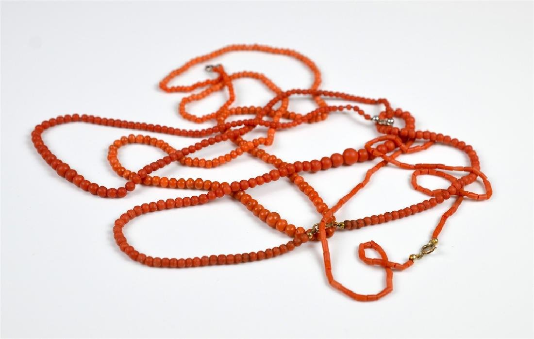 FOUR ANTIQUE RED CORAL BEADED NECKLACES
