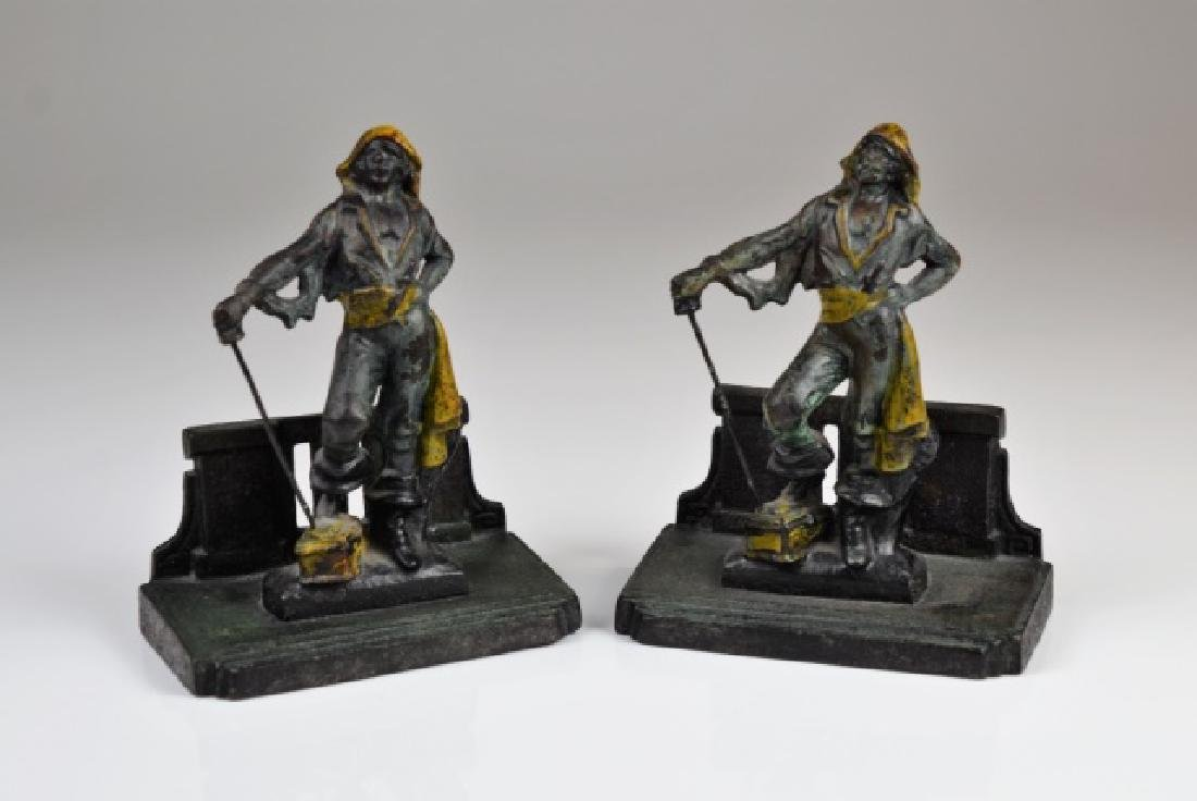 PAIR OF COLD PAINTED CAST IRON BOOKENDS