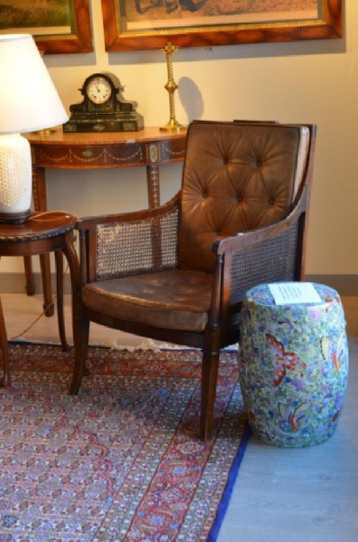 Pair of leather and caned armchairs