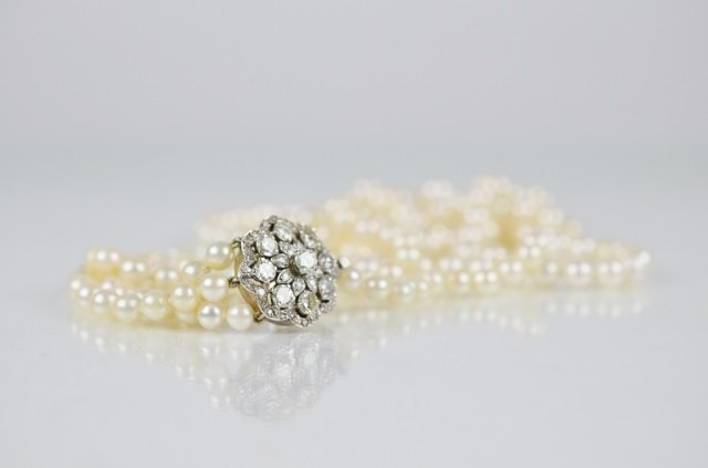 TRIPLE STRAND PEARL NECKLACE WITH DIAMOND CLASP