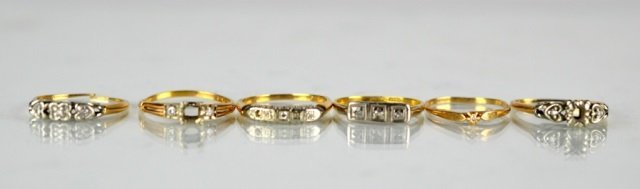 LOT OF SIX GOLD AND DIAMOND RINGS