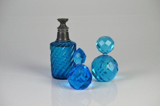 THREE BLUE GLASS VANITY BOTTLES