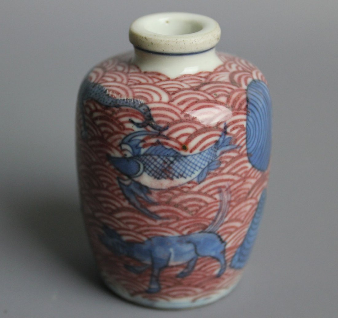 A fine Chinese under glaze blue and copper red snuff