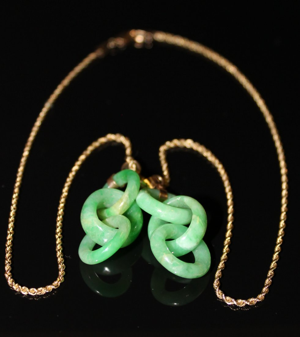 A  Pair of Chinese Jadeite Rings Pendants with a 18K