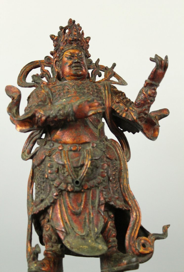 A Rare Chinese Gilt Lacquer Bronze Statue of Lokapala.