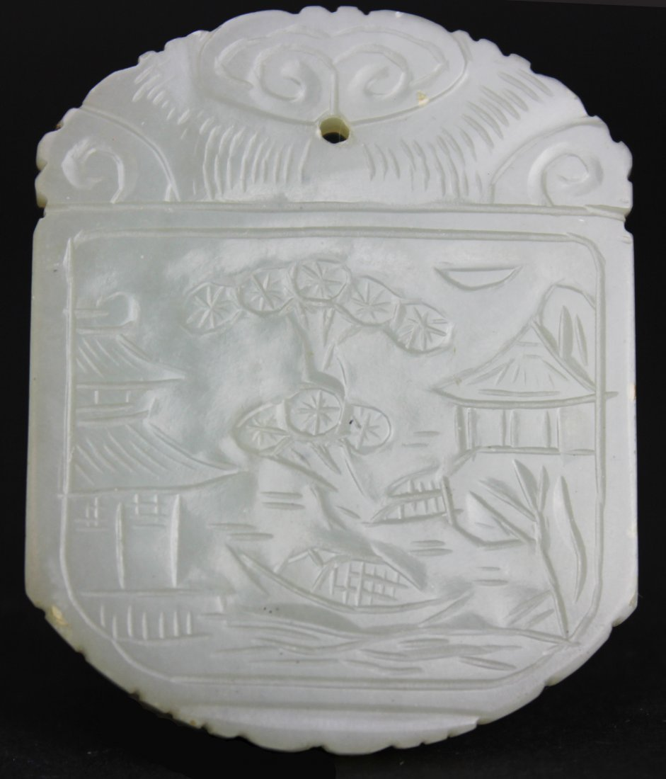 A CHINESE WHITE JADE LANDSCAPE PENDANT