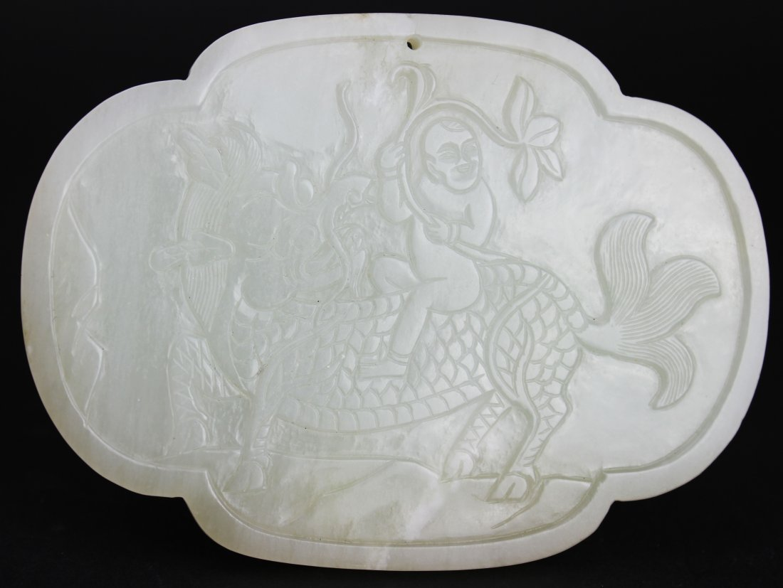 QING DYNASTY, A CHINESE WHITE JADE QILIN CARVED