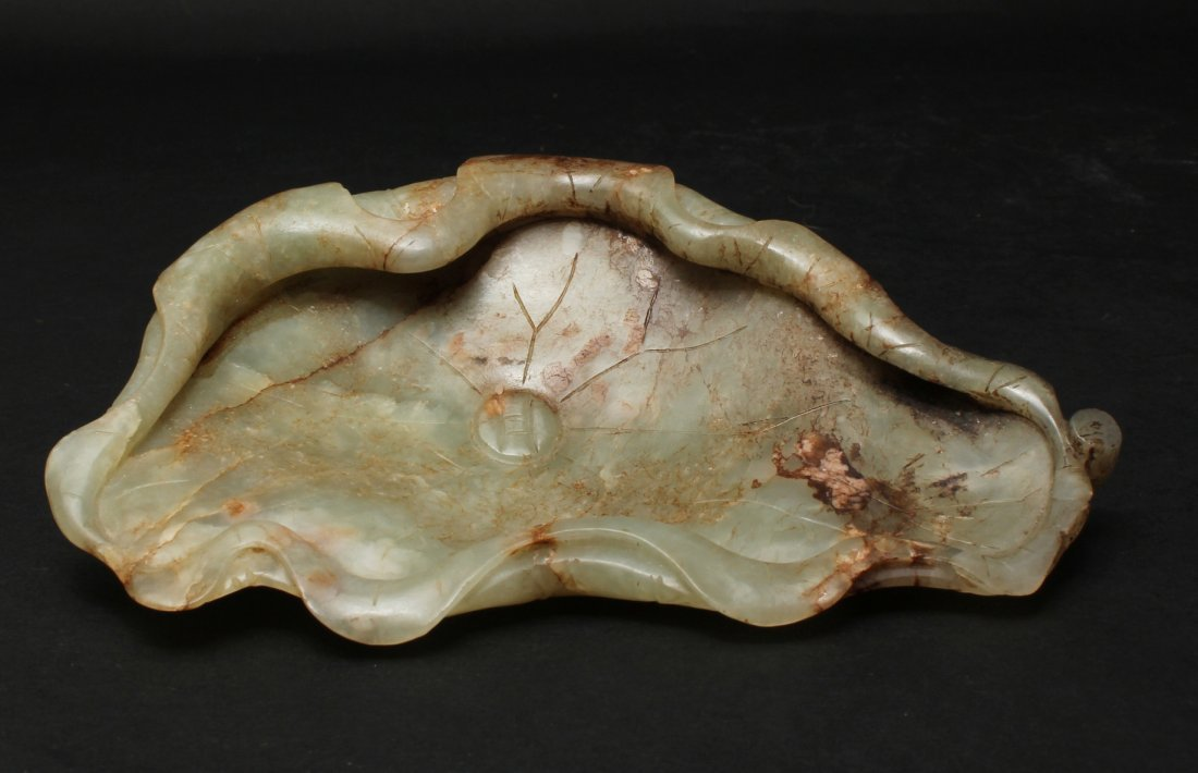 QING DYNASTY, A CHINESE WHITE JADE LOTUS CARVED BRUSH