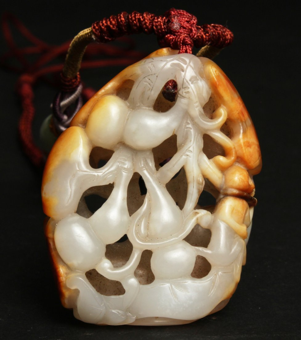 A CHINESE WHITE JADE THROUGH CARVING, QING DYNASTY