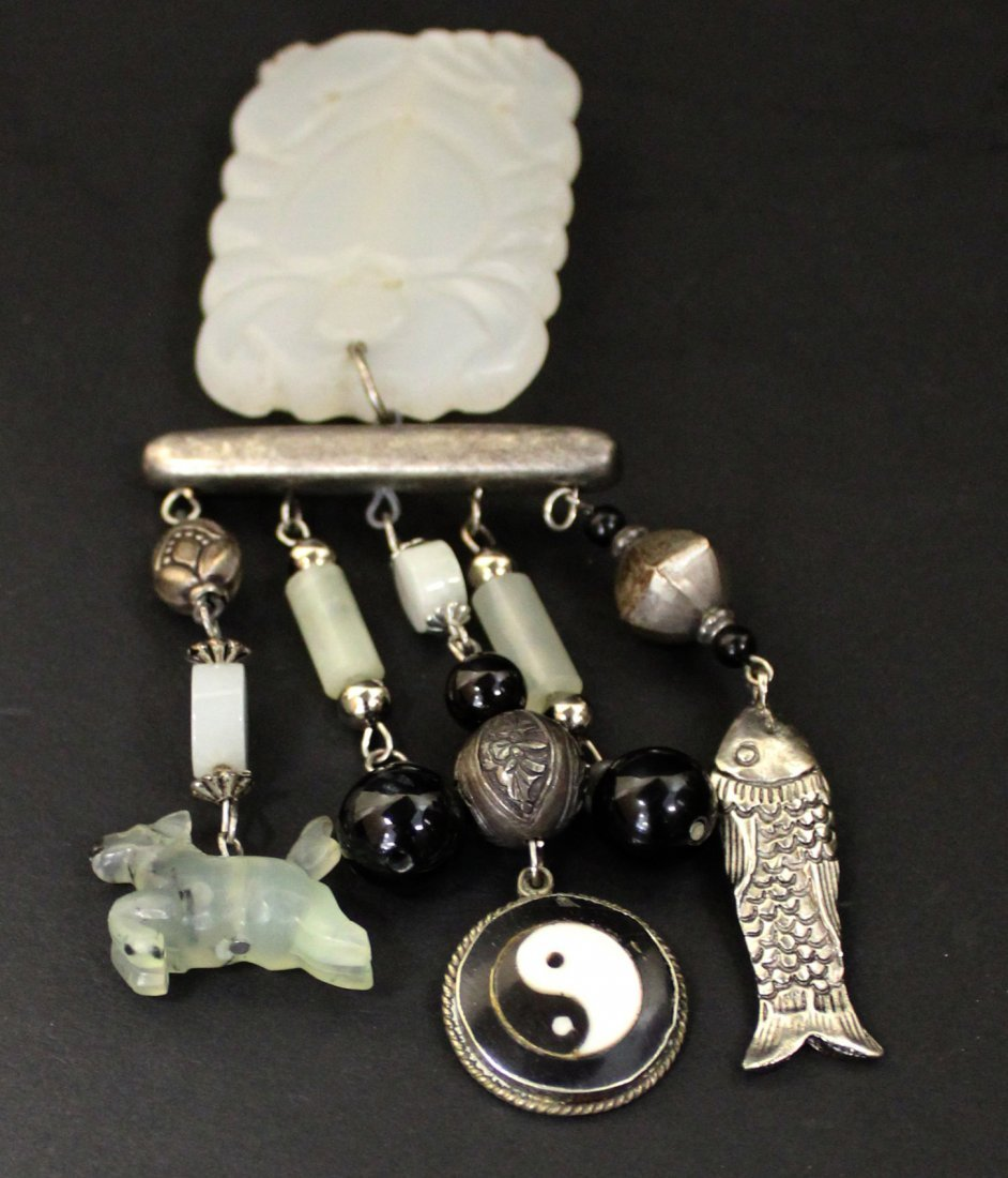 A CHINESE WHITE JADE BROOCH