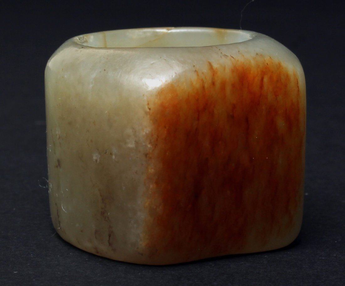 A CHINESE WHITE JADE RING