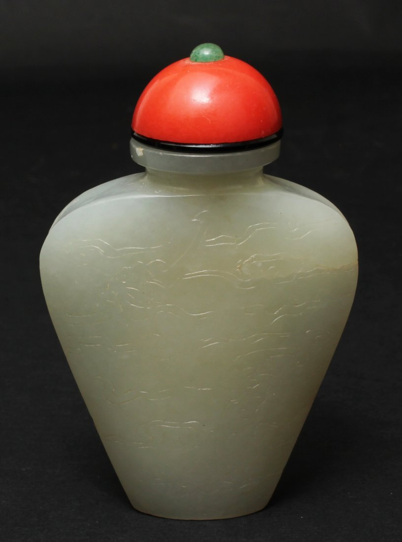 QING DYNASTY, A CHINESE WHITE JADE WITH RED CORAL TOP