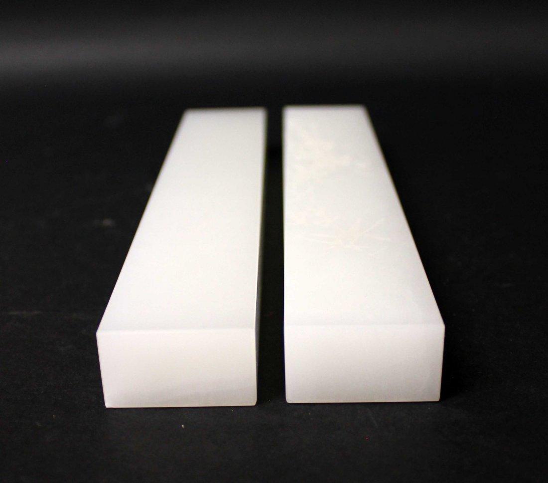 A APIR OF JADE PAPER WEIGHT