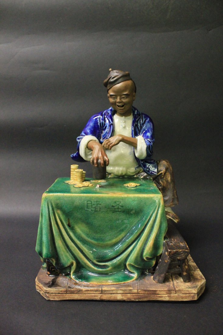 A CHINESE PORCELAIN STATUE