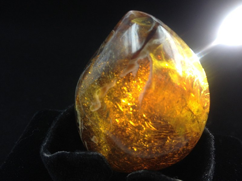 Very Fine Burmite Amber with natural cloudy skin